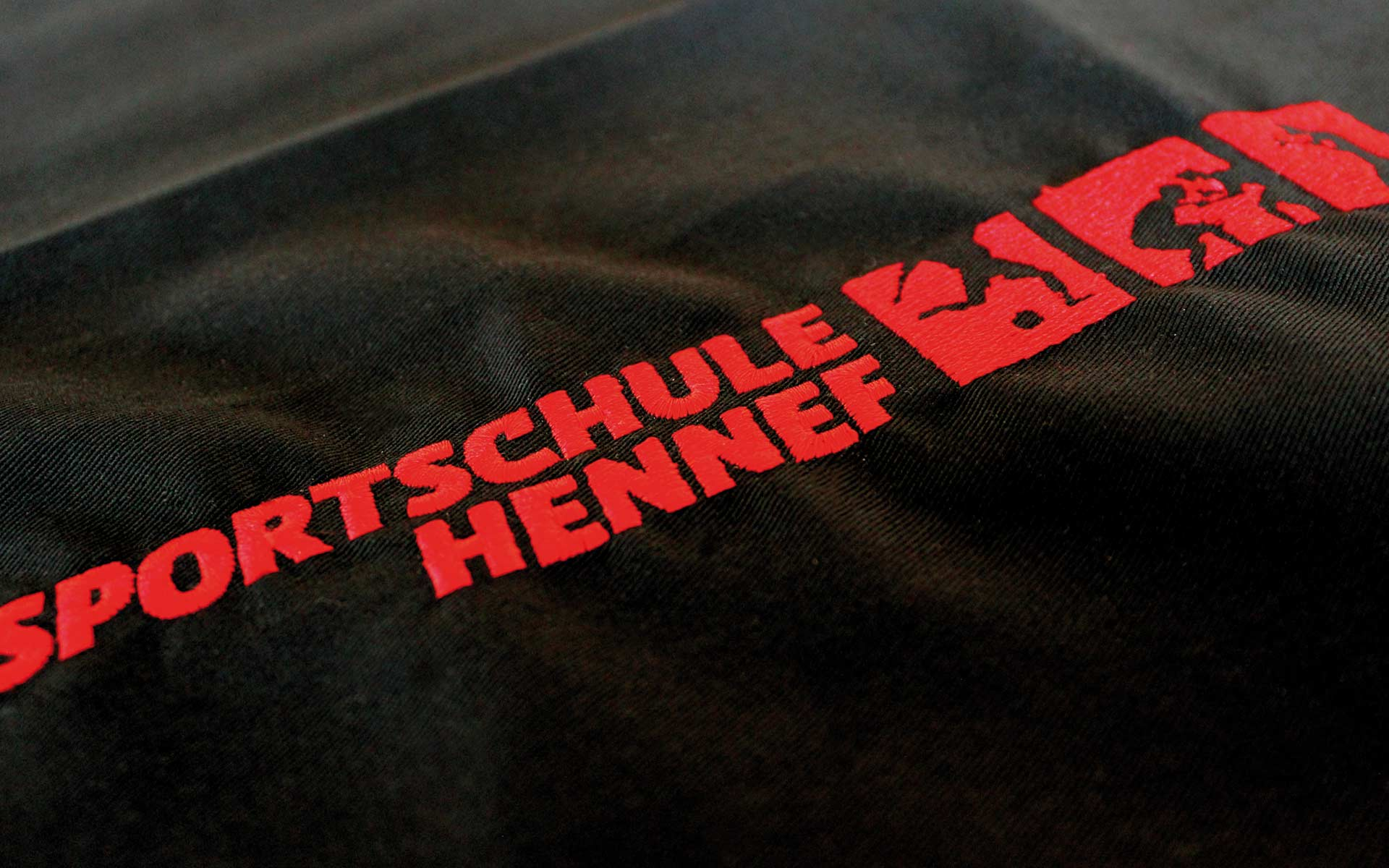 Sportschule-Hennef Corporate Design, Logotype, Textil-Stickerei