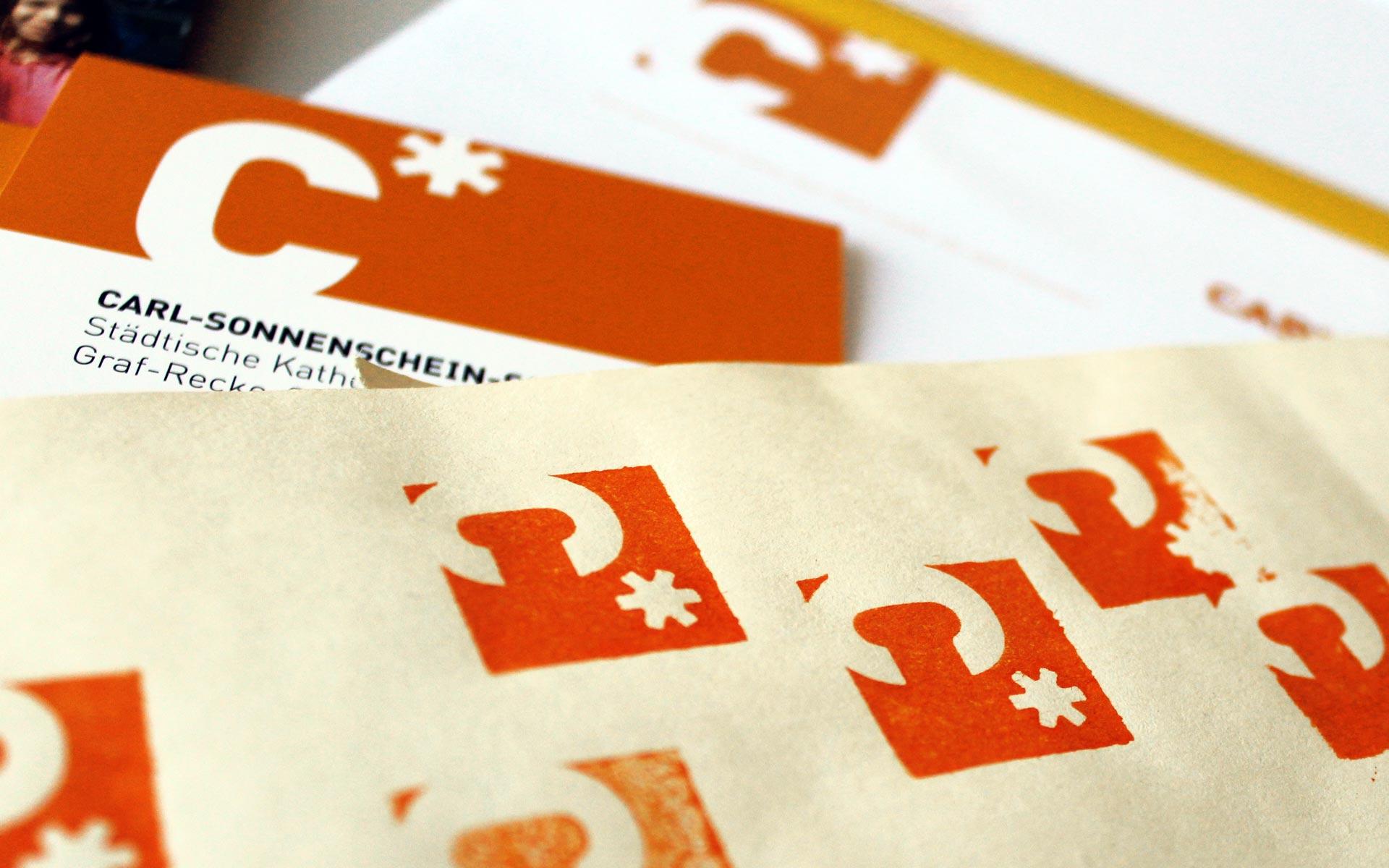 Carl Sonnenschein Schule Corporate Design, Stempel, Logotype